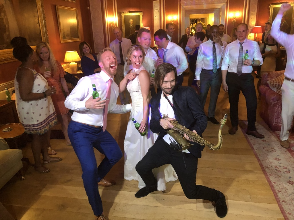 Wedding DJ with saxaphone at Archerfield Hose